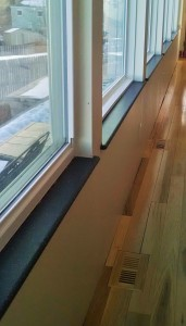 Bank of windows with dark sills cut by Window Sills Direct